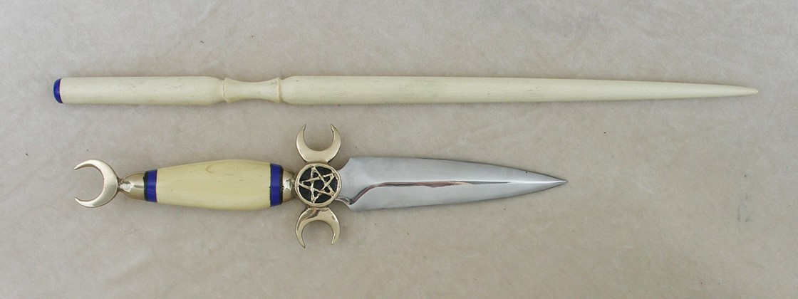 Holly handle with lapis spacers and matching holly wand with lapis gemstone.