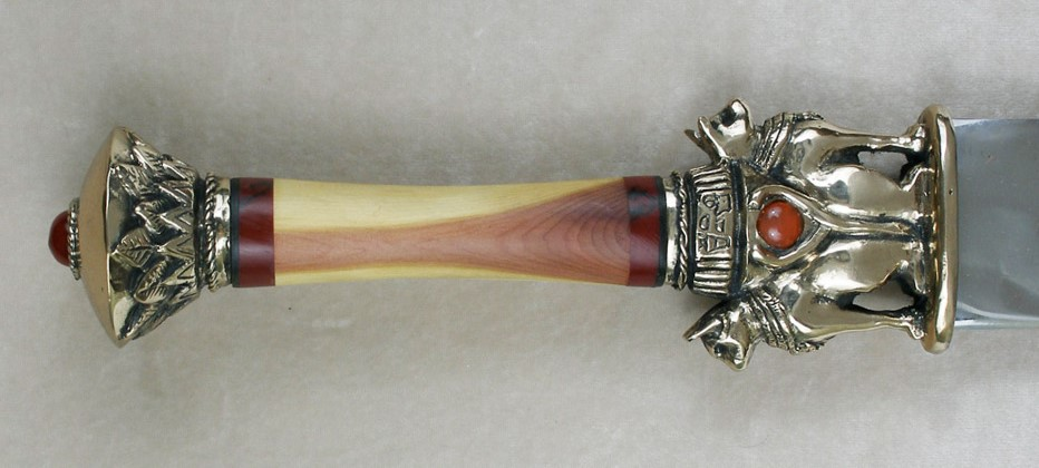 Knife shown with cedar handle and jasper spacers as well as carnelian gemstones