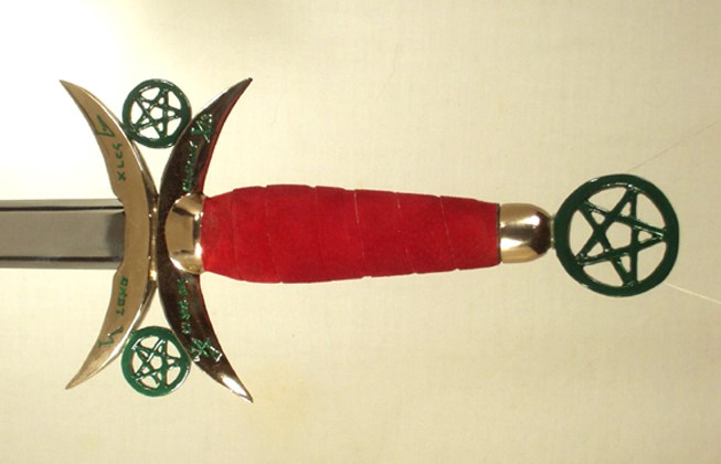 Green open Pentacles with red leather handle