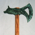 Shown with oak handle and green patina head